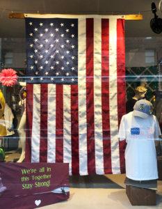 John's Sport Shop Flag in Window